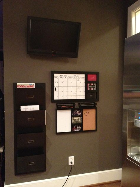 Another view of my organization wall in the kitchen below the T.V. File folder, calendar and cork/dry erase boards all from Kirklands.com