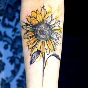 The beauty of this design lies in the fact that it looks like a sketch. The lines are rough but they come together to make a one of a kind sunflower pattern. Yellow, orange are some of the colors used to create this design. #tattoofriday #tattoos #tattooart #tattoodesign #tattooidea