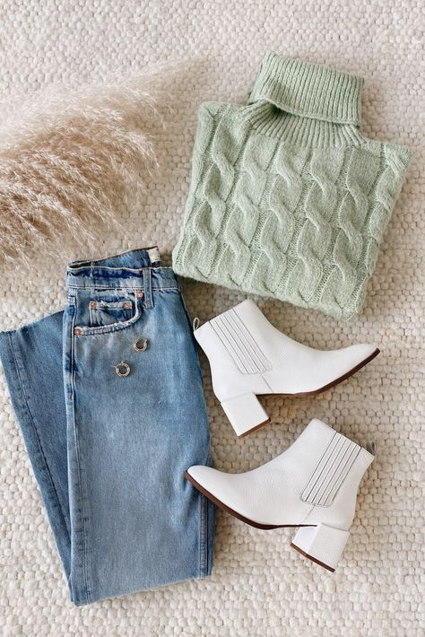 Refresh your staples for the season ahead with Lulus Beside the Fire Sage Green Cable Knit Sweater! Stretchy, cable knit shapes this cute sweater with a slouchy, ribbed turtleneck, dropped shoulders, and trendy balloon sleeves with fitted cuffs. For the perfect transitional spring look pair with white boots and denim. #lovelulus