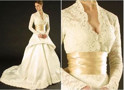 Beautiful ivory Monique Lhuillier lace wedding dress with v-neck and champagne cumberbund - Talk about Regal!  Wow...