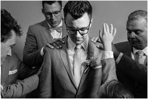 Groom being prayed over | Groom details with brown leather Cole Haan shoes, blush tie and grey suit | Oak Hills Utah Dusty Rose and Gray Summer Wedding | Jessie and Dallin Photography #utahwedding #utahsummerwedding #summerwedding #mountainwedding #rockymountainwedding #blushandgraywedding #blushandgray #oakhillsutah #utahweddingvenue