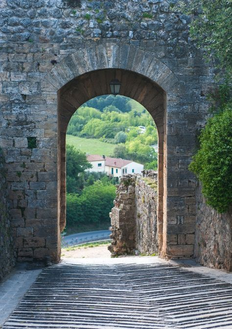 Get lost for a day in Tuscany's Monteriggioni. A medieval walled town located on a natural hillock, it's a perfectly preserved place for a peaceful wander.