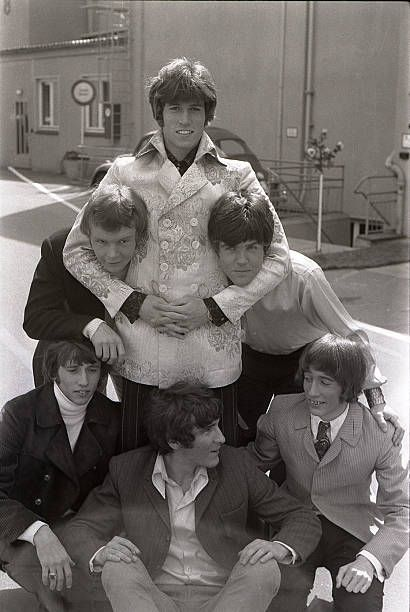 The Bee Gees pose for a group shot Maurice Gibb Colin Petersen Barry Gibb Vince Melouney Robin Gibb outside a TV studio in 1968 in Hamburg Germany