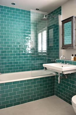 Isn't this bathroom the perfect combination of heritage and modern styling? The fixtures and exclusive use of tiles keeps things traditional and chic, but the choice of green as the main color has absolutely added in some contemporary cool! Is that a shabby chic mirror as well? We need to see it! Bathroom by Studio Duggan