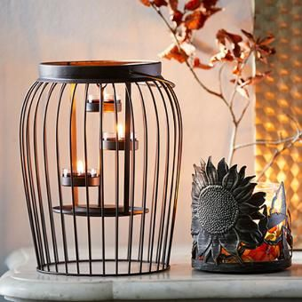 Curved Lantern Shown With Lit Candles Automnale