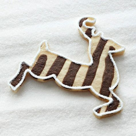 Impress everyone at your cookie exchange with these easy-to-make pinstripe cookies. Learn how to make them here: http://www.bhg.com/recipes/desserts/cookies/santas-reindeer-sugar-cookies/?socsrc=bhgpin121212stripereindeer