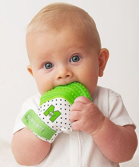 A teething mitten! SO smart!! Munch Mitt Green Munch Mitt on #zulily today! Baby shower gift idea, baby gear must have http://mammahealth.weebly.com/blog/teething-and-your-baby-symptoms-and-remedies