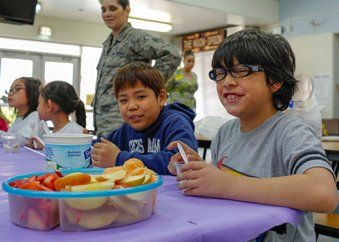 Healthy Living Starts Early for Yokota Students.  Yokota West elementary students enjoying a healthy snack during the last day of the Club 2-1-5-0 assessment.
