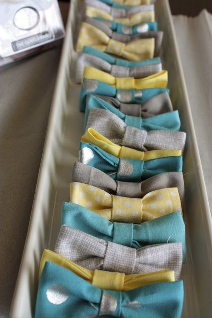 Mini bow ties for the guests at a Little Man Baby Shower! So much cuter than the normal diaper pins!