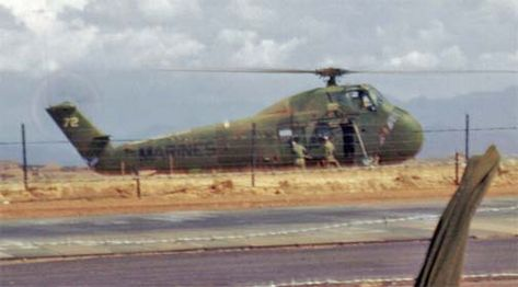 Marine HUS-1 / CH-34 Seahorse helicopter on the runway at Dong Ha, Vietnam, 1 July 1967