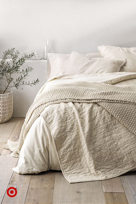 Turn your bed into a summer oasis with dreamy bedding ideas in calm tones  natural fabrics. Bedroom decor level: Zen.