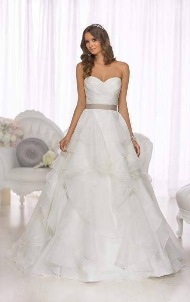 From the Essense of Australia wedding dress collection comes this bold and undeniably elegant gown with a figure-flattering asymmetrical ruched bodice, and soft