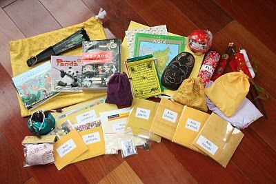 Continent bags - keep postcards, books, flags, cd's, recipes, for geography study of each continent