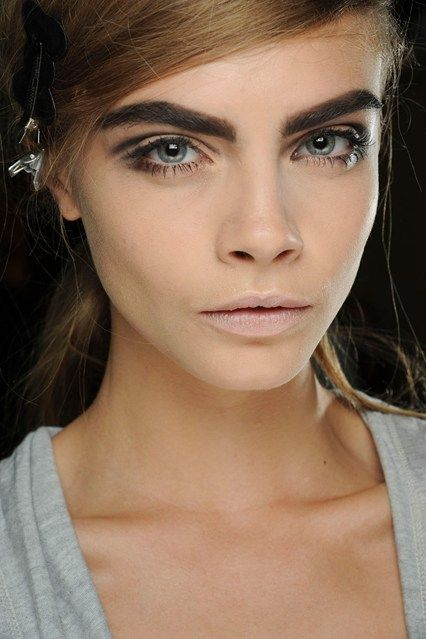 MARC JACOBS - Cara Delevingne shows off the Sixties-inspired make-up look.