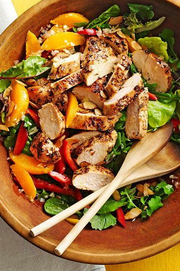 Serve a few healthy options at your Memorial Day gathering. Top a bed of your favorite greens with grilled chicken, sweet peppers, and orange slices. #memorialdayideas #memorialdayparty #sidedishideas #partysidedish #bhg
