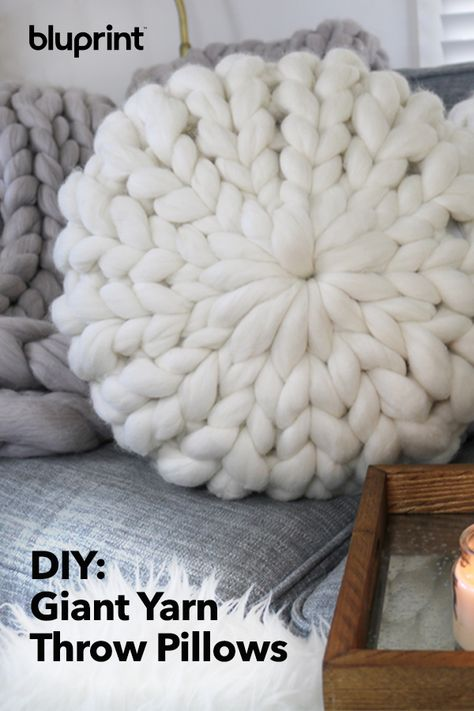 diy pillows DIY Giant Yarn Pillow: If you havent jumped on the giant yarn bandwagon, this is the time! Well show you how to use super (SUPER!) chunky yarn to knit up throw pillows right on your arms. Check out this beginner-friendly giant yarn DIY today! Hand Knit Blanket, Knitted Blankets, Chunky Yarn Blanket, Knit Pillow, Merino Wool Blanket, Diy Yarn Blankets, Chunky Knit Yarn, Crib Blanket, Knit Cowl