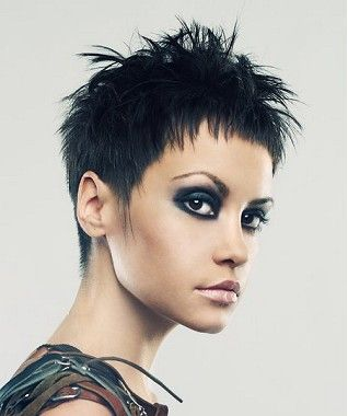 A short black straight spikey womans hairstyle by Web Collections