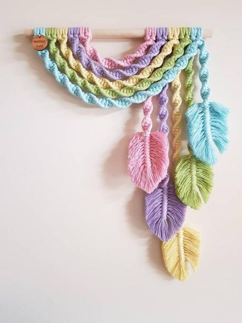Brand new Handmade with 100% recycled cotton, this beauty will add a touch of spunk to any home or make that special gift for a loved one. Perfect baby shower or nursery gift! Unicorn colours. Feathers on one side or double available. Measures approx 50cm in length and 30cm wooden dowel width.