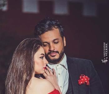 بالصور أجواء رومانسية تجمع إيساف وإلهام عبد البديع