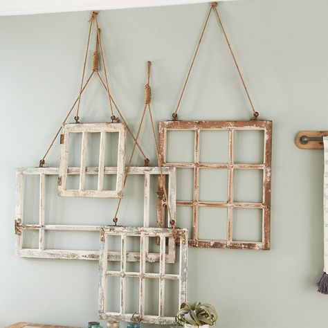 "Hanging windows are the ultimate rustic farmhouse chic accessory!  This set of four gives you different shapes and sizes to decorate a larger wall or across your whole house.  The distressed appeal tells the story of its weathered past that will transform your space with its timeless look. X-Large - 41""W x 24""H; Large - 26""W x 31""H; Medium - 21""W x 24""H; Small - 16""W x 20""H. Vintage Window Decor, Window Frame Decor, Old Window Frames, Window Hanging, Old Window Ideas, Window Pane Crafts, Old Window Headboard, Window Pane Picture Frame, Rustic Window Decor"