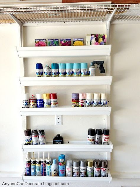 These GREAT STORAGE SHELVES are made of vinyl rain gutters!  A GARAGE FULL OF Ideas on how to Create Space in your garage.. No real instructions on how to make these shelves, though.