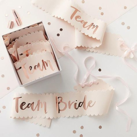 SHOW YOUR TEAM SPIRIT. OK ladies, now get into formation with these 'Team Bride' paper sashes with rose foil lettering-the perfect accessory for the bachelorette party or bridal shower. THE 411   Set of 6 paper sashes with ribbon closure One size fits all Material: Paper 10cm (W) x 75cm (H) Final sale Bachelorette Sash, Nautical Bachelorette Party, Bachelorette Party Decorations, Bride To Be Sash, Wedding Sash, Party Wedding, Wedding Engagement, Boho Wedding, Wedding Dresses
