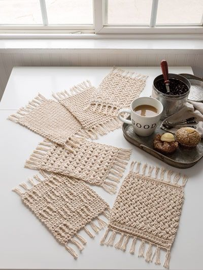 ANNIE'S SIGNATURE DESIGNS: Rustic Mug Rugs Crochet Pattern - Need a quick gift? These adorable coasters will work up in no time. 6 different stitch patterns are - Annie's Crochet, Crochet Gifts, Crochet Humor, Crochet Ball, Doilies Crochet, Crochet Books, Thread Crochet, Mug Rug Patterns, Knitting Patterns