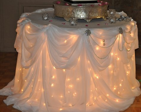 Lights under the table, for the wedding cake table