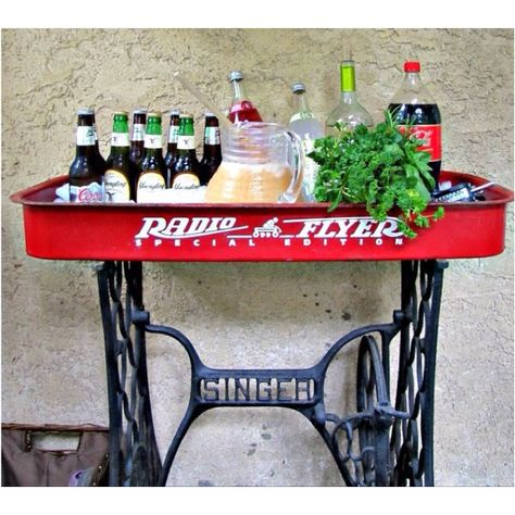 Love this! Child's wagon and old Singer sewing machine base.
