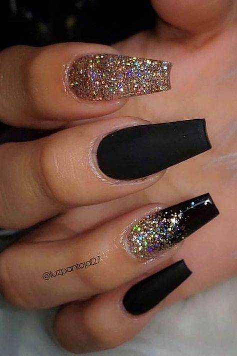 Amazing black nails with gold glitter coffin shaped design Here are some cute winter nail designs between black and silver glitter nails, black and gold glitter nails, and black marble nails designs.