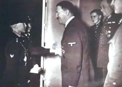 One of the few (if only) photos of Hitler with Joachim Peiper on the right. He was responsible for the wicked Malmedy massacre.