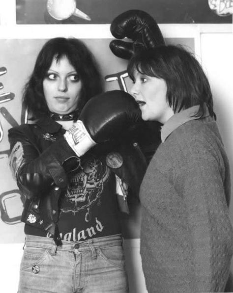 """Gaye Advert & Rosalind Russell  As far as I recall, I had  given the Adverts a bit of a stinker of a review in Record Mirror  for their new single """"No Time To Be 21"""". I seem to recall getting a  phone call from Gaye, threatening to come round and sort me out. My  Editor (Alf Martin) thought it would be fun to get hold of a pair of  boxing gloves and get a photographer to come in to set up a picture.  In the event, she was absolutely charming and resisted the ..."""