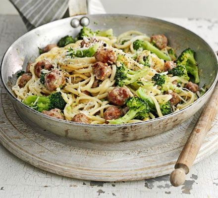 A spin on the Italian classic using sausage meatballs, spaghetti and greens - on the table in half an hour