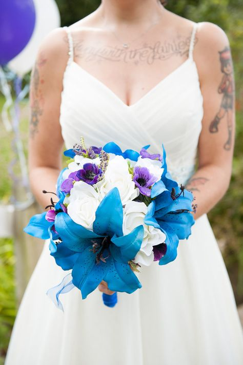 Blue and White Wedding ideas - Quirky Colourful Blue Barn Wedding Silk Flowers Bouquet Bride http://fionasweddingphotography.co.uk/