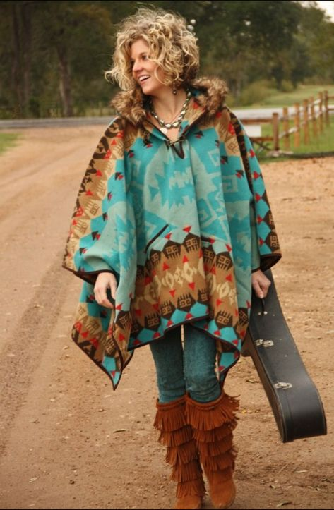 WHERE OH WHERE CAN I GET THIS??? STUNNING & SO ME!! TRIBAL PRINT PONCHO!!! The turquoise/teal with brown is SO perfect!! Already have the boots, jeans and even the guitar...just need this poncho!! :):):)