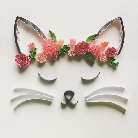 """This framed art, titled """"Flower Crown Cat"""", is handcrafted from small strips of paper that have been rolled and shaped to create original 3D artwork perfect for any room in your house.  The finished product is framed in your choice of black or white frame. The frame has dimensions of 6"""" tall by 6"""""""