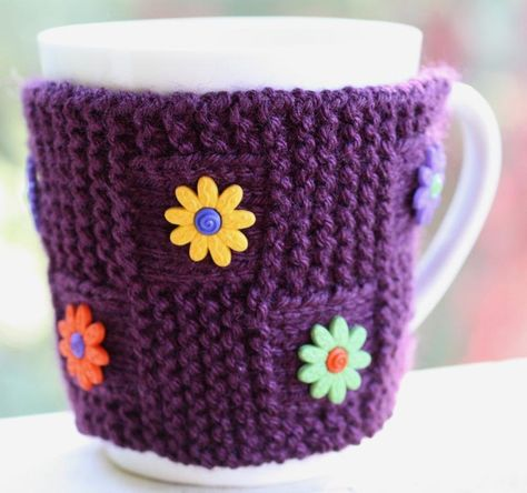 Knitted mug cozy/cosy mug hug coffee sleeve deep purple-burgundy with flower buttons. via Etsy.