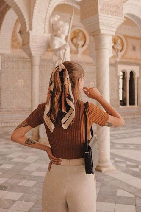 Low or high, tying a simple knot around your ponytail and letting the ends hang out in the back it's an easy way to add volume and length to your ponytail #hair #hairstyles
