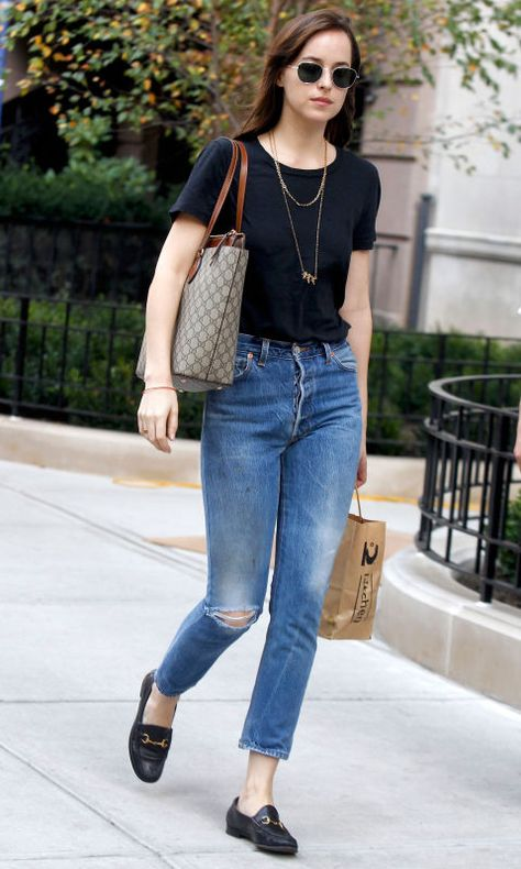 20 October Dakota Johnson kept it casual in a black T-shirt, jeans and Gucci loafers as she ran errands in New York.