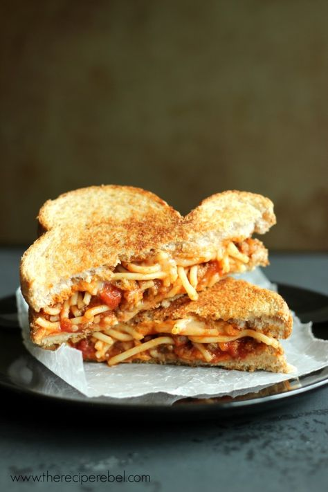 Spaghetti and Garlic Toast Grilled Cheese -- meaty, saucy, toasty, garlicky and toasty all in one. You need to try these! www.thereciperebel.com