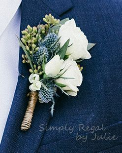 Boutonniere with white roses and blue thistle. Ideal for the natural boho weddin