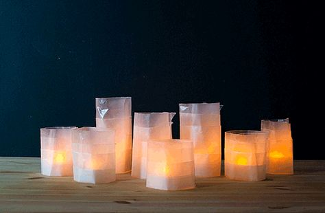 Cut some wax paper are varying heights and place a battery-operated tea lights in the middle for this child (or dorm-room) safe glowing decor!