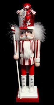 A NUTCRACKER DRESSED IN RED AND WHITE.