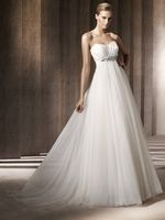 The simplicity of an empire with the drama of a full skirt - by Pronovias.