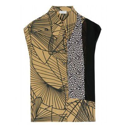 Dries Van Noten - fabulous combination of fabrics. Love the long collar points, too.