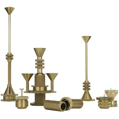 A range of brass home accessories based on cogs by British designer Tom Dixon