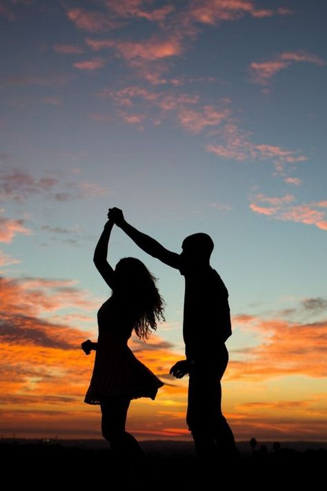 dancing and twirling into the sunset engagement photo