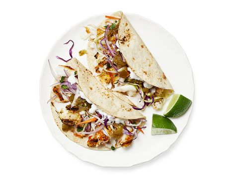 Recipe of the Day: Grilled Fish Tacos with Lime Slaw | Grill up seasoned white fish, then wrap in corn tortillas (along with all the fixings) for delicious tacos in 20 minutes flat.