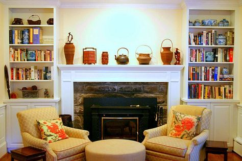 Can't seem to track this bookcase/fireplace combo to its original source, so simply pinning it for inspiration without further information.