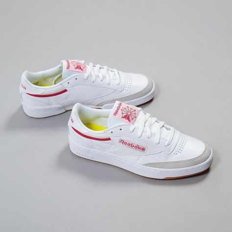fb07c154254 Just dropped  fatbuddhastore is this  reebok Club C 85 Court in White Grey Red.  Clean lines compelling materials and authentic pops of colour make these ...